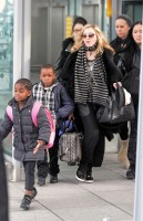 Madonna arriving at Heathrow airport, London (14)