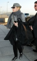 Madonna leaving London, Heathrow Airport, April 12th 2011 (1)