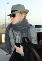 Madonna leaving London, Heathrow Airport, April 12th 2011 (7)