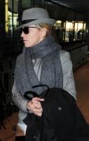 Madonna leaving London, Heathrow Airport, April 12th 2011 (9)