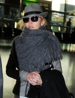 Madonna leaving London, Heathrow Airport, April 12th 2011 (12)
