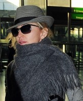 Madonna leaving London, Heathrow Airport, April 12th 2011 (14)