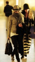 Madonna leaving London, Heathrow Airport, April 12th 2011 (16)