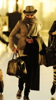 Madonna leaving London, Heathrow Airport, April 12th 2011 (20)