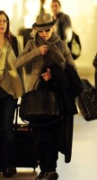 Madonna leaving London, Heathrow Airport, April 12th 2011 (21)