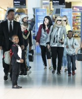 Madonna and family arriving at Heathrow Airport, London (18)