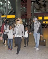 Madonna and family arriving at Heathrow Airport, London (24)