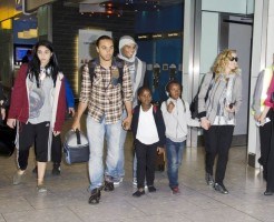 Madonna and family arriving at Heathrow Airport, London (26)