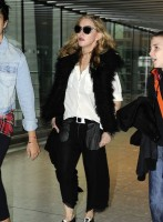 Madonna at Heathrow airport London, 4 September 2011 (3)