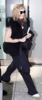 Madonna at Heathrow airport, October 24 2011 (7)