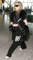 Madonna at Heathrow airport, October 24 2011 (11)