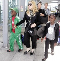 Madonna arrives at Heathrow Airport in London - 19 July 2013 (2)