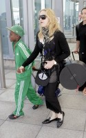 Madonna arrives at Heathrow Airport in London - 19 July 2013 - update (5)