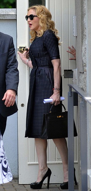 Madonna Attends David Collins Funeral In Monkstown