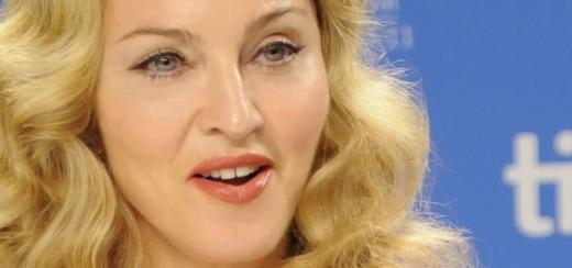 Madonna à la conférence de Presse du Festival International du Film de Toronto [12 Sept 2011 - HQ/MQ pictures]