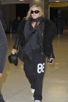 Madonna arrives at JFK airport on her way to London, 21 October 2011 (1)