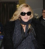 Madonna arrives at JFK airport on her way to London, 21 October 2011 (2)