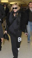Madonna arrives at JFK airport on her way to London, 21 October 2011 (3)