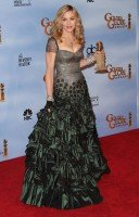Madonna at the Golden Globes Press Room, 15 January 2012 - Update 01 (54)